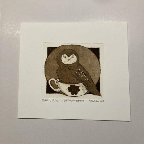 Pöllö kahvikupissa